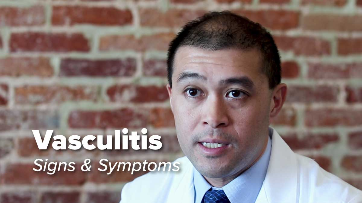 Dr. Eric Gapud sitting in front of brick wall discussing vasculitis